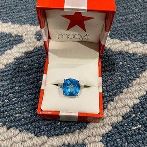 14K white gold ring w Topaz stone and diamonds.
